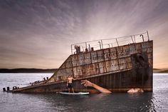 hula paints a floating female on a sunken ship in hawaii while surfboardingcharmiesbywendy #hestoncharm #missroo