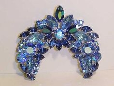 Hey, I found this really awesome Etsy listing at https://www.etsy.com/listing/208567882/vintage-verified-de-juliana-brooch-blue
