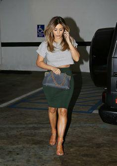 5719358def67 Kim Kardashian carries a grey crocodile Bottega Veneta bag in Beverly Hills.
