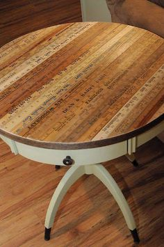 Table topped with old yardsticks
