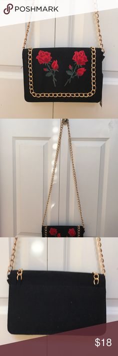 Nicole Floral Patch Chain Trim Cross Body Bag Boohoo Black one size cross body purse with roses embroidered on the front and a gold chain for the trim and handle. The chain handle is about 2 ft long and the purse itself is about 10 inches wide. Never used with tags still on and great condition!! Never used just because it's not my style and I have a few other purses that I usually use but super cute and roomy!! Boohoo Bags Crossbody Bags