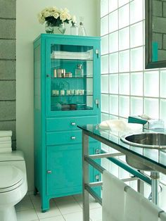 Freestanding Function-If you have room in the bathroom, freestanding pieces of furniture offer the most flexibility when it comes to storing bath necessities. Here, an old-fashioned pharmacy cabinet with a fresh coat of fun paint offers glass-front display and storage space on top and closed storage in the drawers and cabinet below