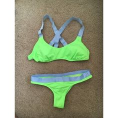 neon green Victorias Secret brazilian thong bikini VS no longer sells this--- my favorite bikini ever!! top is L but I think runs small because it is slightly loose on me but still fits me enough to wear and I'm 34 b/c , bottom is XS Brazilian bottom. not selling this one separately! only in a set :) Victoria's Secret Swim Bikinis
