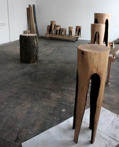 Titled 'Burnt Out' (Ausgebrannt), well, they are indeed – the char-encrusted voids are the result of searing each seat, carved a unique shape with heat and flame rather than a saw or chisel.