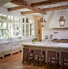 Top 20 Most Beautiful Wooden Kitchen Designs To Pin Right Now - 13. EXPOSED WOODEN BEAMS AND WOODEN WHITE KITCHEN FURNITURE