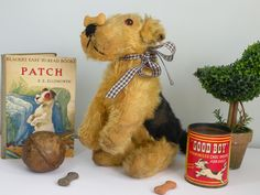 Patch the dog a 1930's Old dog who loves showing off his trick of balancing dog biscuits on his nose www.onceuponatimebears.co.uk