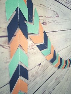Boho Baby Party Collection at etsy.com/shop/emptynesthomegoods- chevron arrow garland in coral, navy, and aqua; tribal theme baby shower; wild one first birthday party.
