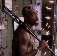"Tupac Shakur in scene from ""Toss It Up"" video Whats Wallpaper, Tupac Wallpaper, Tupac And Biggie, Tupac Pictures, Tupac Makaveli, Arte Hip Hop, Best Rapper, Tupac Shakur, Aesthetic Collage"