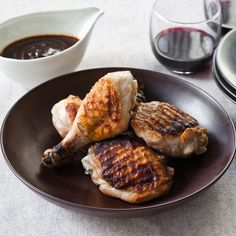 Chicken Legs with Roasted Garlic-Ancho Sauce  | Food & Wine