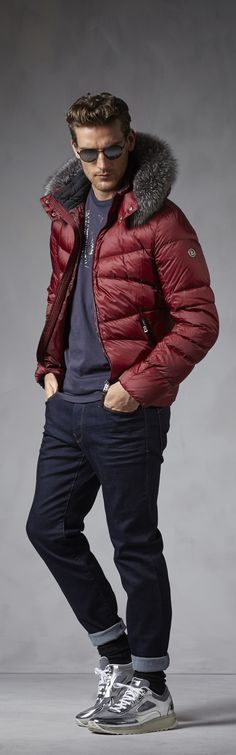 Light some fires to warm up this winter with a deep-red statement down jacket from Bogner Man. The color is refined yet bold, and the uneven quilting and luxurious fur hood make it an appealing eye-catcher.