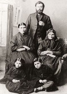Henriette Riel-Poitras with her brother Louis Riel's children (Angelique and Jean), her husband Jean-Marie Poitras, and Julie Lagimodiere (Louis Riel's mother).