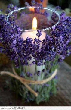 Affix lavender on a glass vase, tie it and put a candle in the middle. Very cute & smells great! #bridalbites