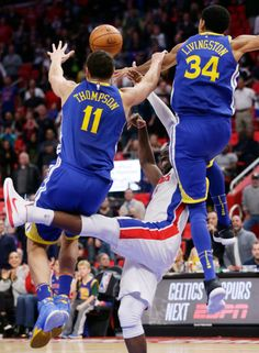 Detroit Pistons guard Reggie Jackson, center, is stopped by Golden State Warriors guards Klay Thompson (11) and Shaun Livingston (34) during the fourth quarter of an NBA basketball game Friday, Dec. 8, 2017, in Detroit. The Warriors defeated the Pistons 102-98. (AP Photo/Duane Burleson)