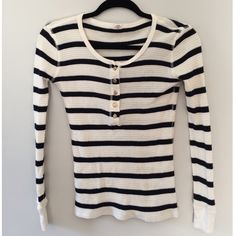 J. Crew Vintage Thermal Henley in Stripe This shirt is in excellent used condition with no stains or tears or signs of wear. The colors are cream with navy stripes and gold buttons. 100% cotton. Extra button attached to tag inside. Too small for me or I would for sure keep it. There is one other XXS J. Crew item in my closet - a cozy gray funnel neck sweatshirt. Bundle for a 15% discount! J. Crew Tops