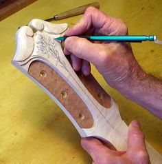 Bob Benedetto sketches the relief carving design on the Benedetto 45th Anniversary Cremona Serial #S2129GP.