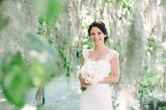 Bridal session at the historic Legare Waring House under the spanish moss in Charleston, SC.  Bridal bouquet of blush and ivory peonies!