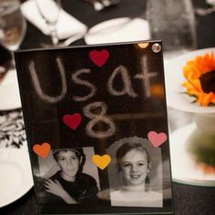 Wedding Table Numbers! Each table number has a picture of the bride and groom at that age. Supper Cute!