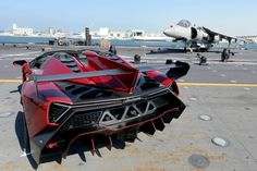 The formal unveiling of the 2014 Lamborghini Veneno Roadster took place on an aircraft carrier.