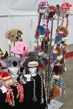 Ira Rott Fashion, Craft Show, Fairs and Exhibitions ( Handmade Crochet Animal Hats ). Sock Monkeys with MOHAWKS! Crochet Craft Fair, Crochet Crafts, Crochet Projects, Craft Projects, Fall Craft Fairs, Craft Show Ideas, Fall Crafts, Craft Booth Displays, Hat Display