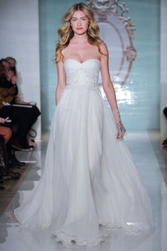 A favorite from the Reem Acra Spring 2015 collection. Love how the gown floats down the runway!