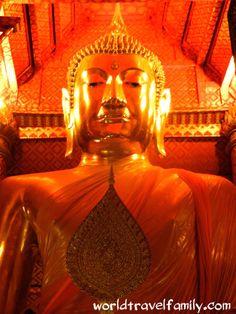 Ayuttaya or Ayudya in Thailand. Huge gold Buddha. Visiting Ayutthaya on your trip to Thailand.
