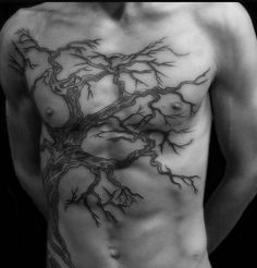 Not a kraken, but it's still a GORGEOUS example of how top surgery scars can be covered up!