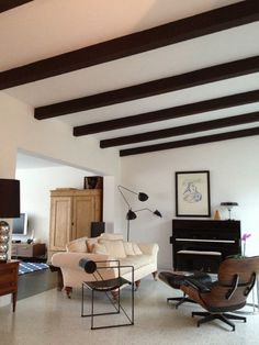 Love the dark wood beams and the cool shapes...LOVE.  Living With Kids: Debora Kolb