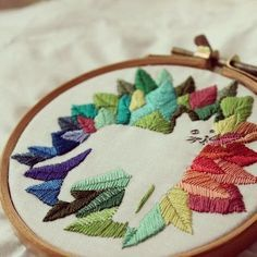 Bugambilö's Galatea hand embroidery ~ I love the negative space design -- Really amazing handwork!