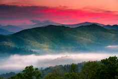 A spring sunrise view with a layer of mist over the Smoky Mountains