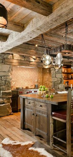Fabulous rustic kitchen. A pot rack seems like a great idea.