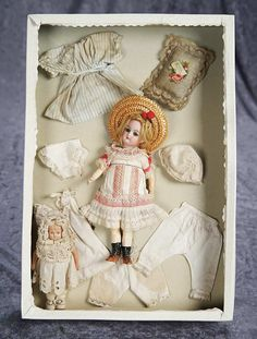 """7"""" (18 cm.) German Bisque Doll in Original Presentation Box with Costumes and Little Doll 500/800"""