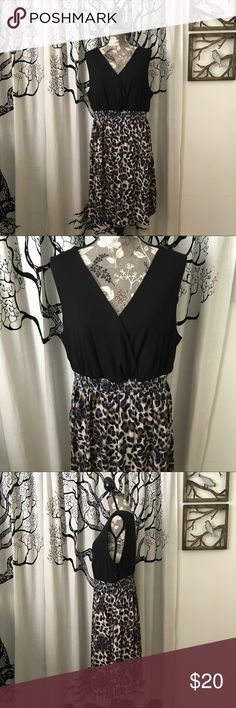 Torrid Soft Animal Print Dress w/ Pockets SZ 18/20 Super cute, super soft dress by Torrid in black with a fun animal print skirt. Pockets! Crossover bust. Bodice is super soft, fuzzy rayon/spandex with a rayon skirt. Elastic waist. Gently loved, excellent condition with no flaws. Torrid SZ 2 - 2X or 18/20. Selling for a friend and was advised true to size. Please check measurements in photos. Really cute for the final days of summer, or pair with a cardigan this fall! torrid Dresses Midi