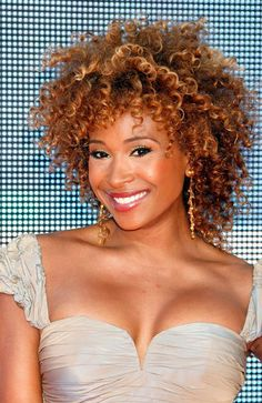 TV personality Tanika Ray layers her sun-kissed curls for luscious body and movement.