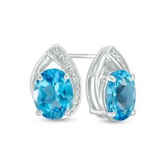 Zales Oval Lab-Created Blue Sapphire and 1/10 CT. T.w. Diamond Frame Stud Earrings in Sterling Silver P23Mp