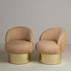 A Set of Four Brass Based Tub Upholstered Swivel Chairs 1960s
