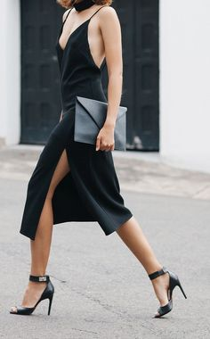 Spaghetti strapped, midi-dress with a slitted skirt and plunging neckline.                                                                                                                                                      More