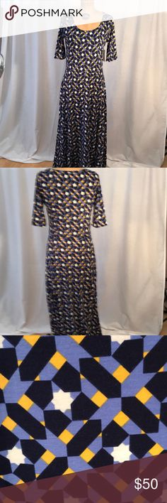 Dress Lularoe Ana dress. Full length with blue, black, white and yellow print. Flattering for all body types. 96% polyester and 4% spandex , soft material. LuLaRoe Dresses Maxi