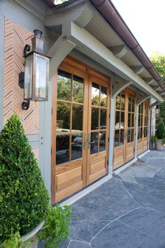 Really nice use of brick around gas lanterns with beautiful doors that open onto the patio.