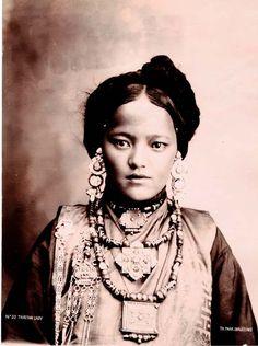 Old postcard of Tibetan girl.