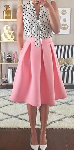 I love the polka dot and style of top. Love the color and length of skirt.