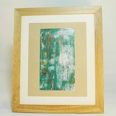 This unique, textured abstract painting is an affordable way to decorate your home with original artwork. The deep blue green colour dominated the majority of the composition with large white area layered on top. There are also brown and gold accents adding depth and interest.    Name: Painted Door    Date: January 2016    Medium: Acrylic Paint on high quality artists paper    Paper Measures: 296 x 210 mm  Artwork Measures: 200 x 113 mm    Varnished with UV protective gloss varnish for…