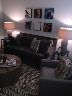 HomeGoods concrete lamps light up this masculine apartment. Sponsored by HomeGoods Happy by Design