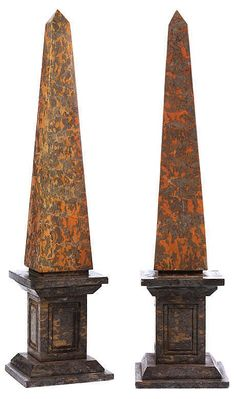 Pair of decorative obelisks, Gray mottled and gray ocher mottled marbles, each on a high pedestal on a square plinth Height: ca. 101 cm. 19th century.