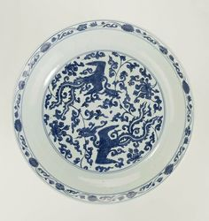 Charger with two phoenixes flying between lotus scrolls, Jiajing period, c. 1525 - c. 1550, blue and white porcelain, h 9.5cm × d 43.5cm. AK-RAK-1971-1. Rijksmuseum, Amsterdam.