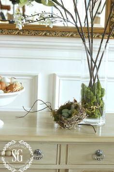 MAKING FAUX FLOWERS LOOK FABULOUS-blooming branches with mossy base-stonegableblog.com