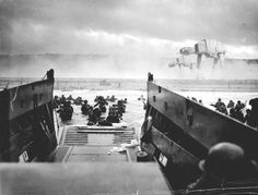 This famous photograph, taken by Private E. Sullivan, shows what American infantry faced during the Normandy landing at Omaha beach. Many died before even reaching the beach drowned under the weight of their equipment.
