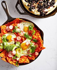 Our shortcut chilaquiles use corn chips to avoid frying tortillas. The sauce is a quick puree of canned fire-roasted tomatoes, onion, garlic and chipotle peppers. Serve with fried eggs, quick-pickled radishes, and an appetite for adventure. Get the recipe!