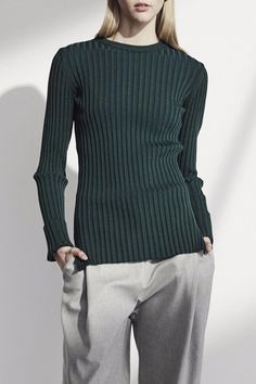 Green long sleeve ribbed sweater. Crewneck tight fit intended.  Green Ribbed Sweater by Achro. Clothing - Sweaters - Crew & Scoop Neck Iowa City Iowa