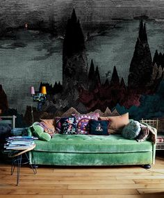 Plush, mint green sofa, comfy and shabby.  Japanese inspired mountain wall mural.  36 Stunning Bohemian Homes You'd Love To Chill Out In