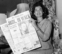 "Jackie Kennedy reading about JFK's nomination in the ""Boston Globe"" newspaper back home in Hyannis Port, MA, July 14, 1960"